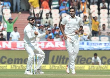 India's captain Virat Kohli (L) and Ravichandran Ashwin celebrate the wicket of Bangladesh's Shakib Al Hasan on the third day of a solo Test match between India and Australia in Bengaluru. Getty Images