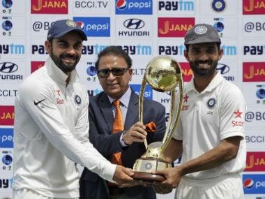 Virat Kohli, Ajinkya Rahane and Sunil Gavaskar pose with the Border-Gavaskar Trophy. AP