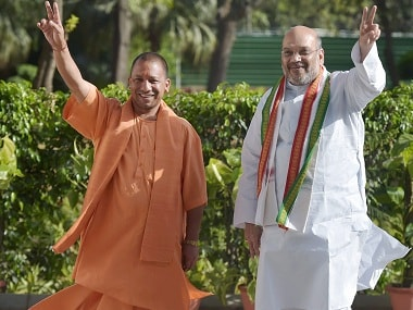 Yogi Adityanath with BJP President Amit Shah in New Delhi. PTI