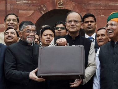 New Delhi: Finance Minister Arun Jaitley (C) stands outside his office at North Block holding the briefcase containing the Union budget for 2017 and is flanked by MoS Arjun Meghwal (R) and Santosh Gangwar (L), on Wednesday,in New Delhi. PTI Photo by Vijay Verma(PTI2_1_2017_000008B)