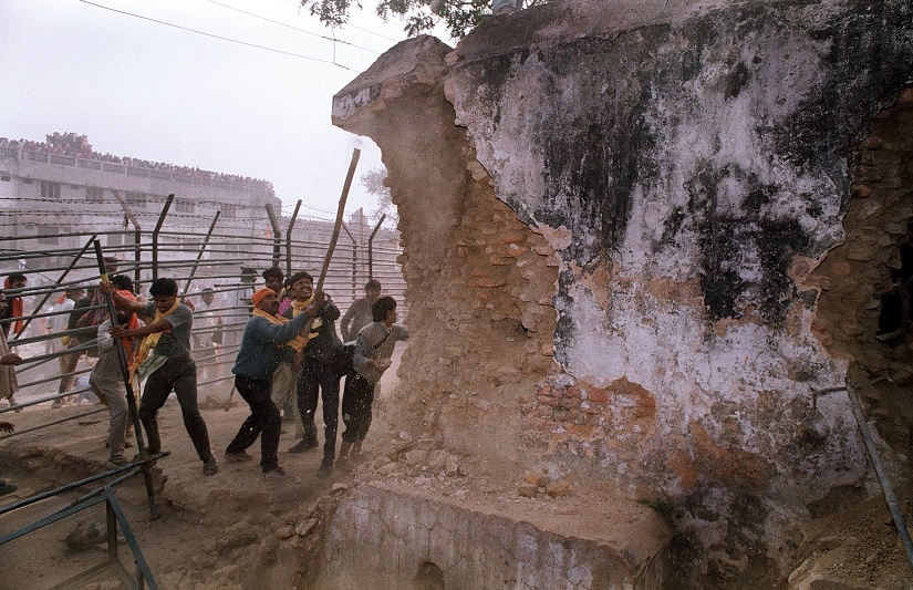 File image showing Hindu fundamentalists attacking the wall of the 16th century Babri Masjid Mosque with iron rods at a disputed holy site in the city of Ayodhya. AFP