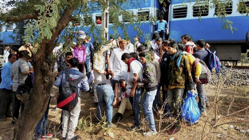 People attend to the injured after the Bhopal-Ujjain train blast. PTI