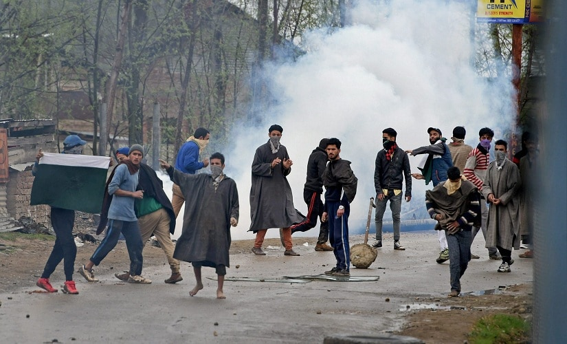 A group of youth pelting stones on security forces during an anti-militant operation at village Durbugh in Chadoora area of central Kashmir's Budgam district on Tuesday. PTI