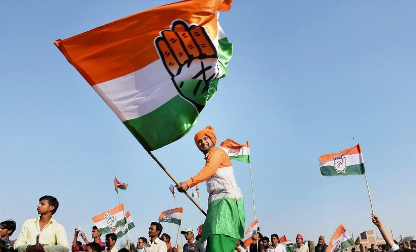 A Congress supporter waving a flag during Rahul Gandhi's rally. PTI