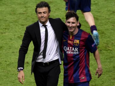 File photo of Barcelona manager Luis Enrique (L) and star player Lionel Messi. AFP