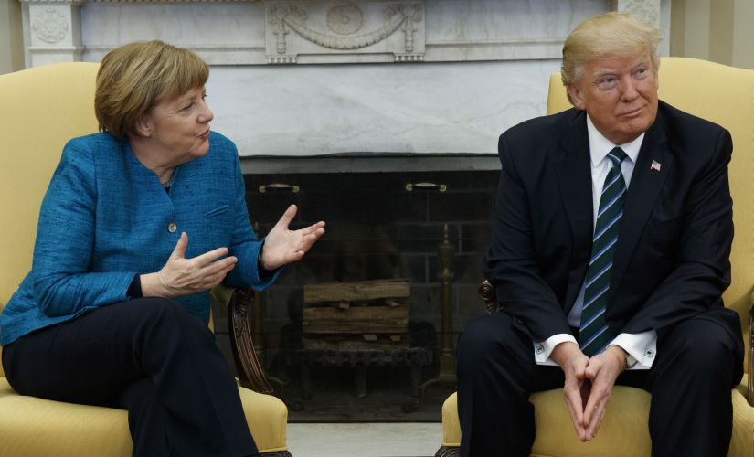 US President Donald Trump meets German Chancellor Angela Merkel in the Oval Office of the White House in Washington on  Friday. AP
