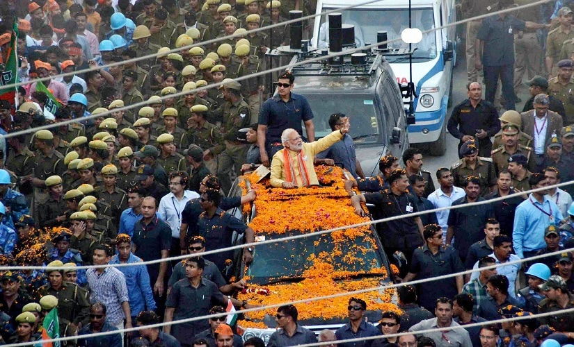 Prime Minister Narendra Modi during his road show in Varanasi on Sunday. PTI