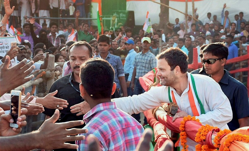 Rahul Gandhi reaching out to his supporters during a rally. PTI