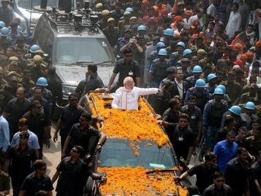 Varanasi: Prime Minister Narendra Modi greets crowd at a road show in Varanasi on Saturday. PTI Photo (PTI3_4_2017_000051B)