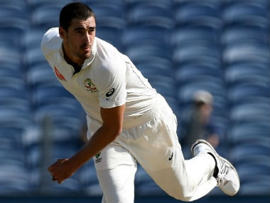 Mitchell Starc bowls during the first Test between India and Australia in Pune. AFP