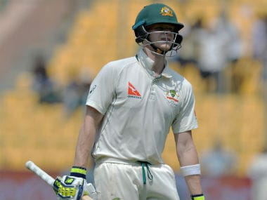 Steve Smith walks back after his dismissal during Day 4 of the 2nd Test between India and Australia in Bangalore. AFP