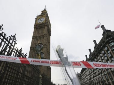 A singles white rose, a tribute to the victims of Wednesday's attack, is placed near the Houses of Parliament in London on Thursday. AP