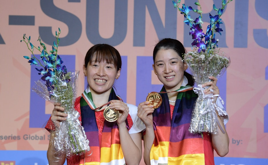 Japan's Shiho Tanaka (L) and Koharu Yonemoto (R) pose for pictures with their gold medals after winning their women's doubles final match against Japan's Naoko Fukuman and Kurumi Yonao at the India Open 2017 tournament in New Delhi. AFP