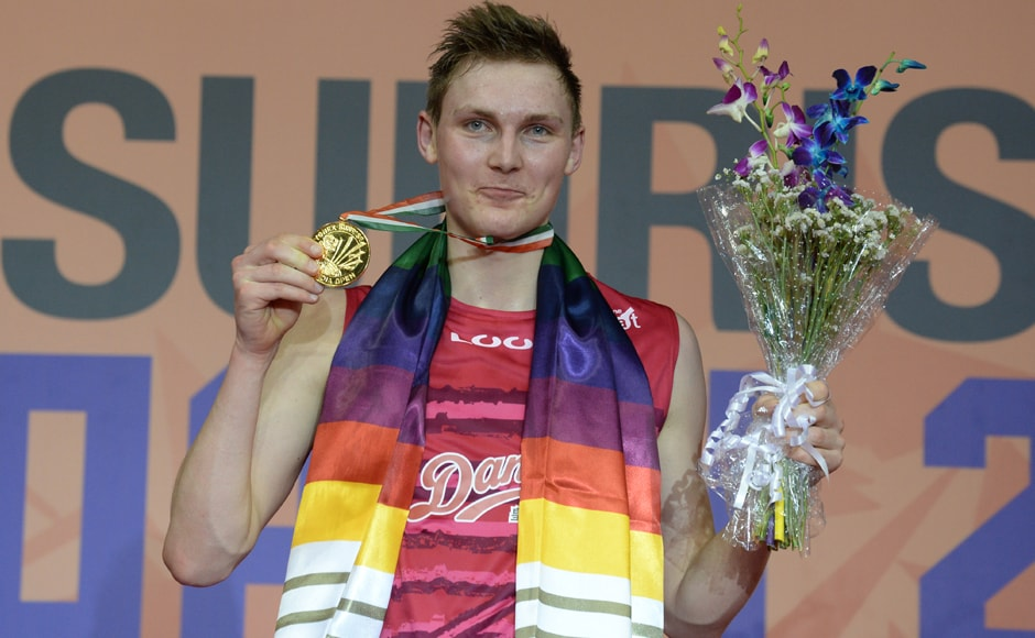 Denmark's Viktor Axelsen poses for pictures with his gold medal after winning the men's singles final match against Chou Tien Chen of Taiwan at the India Open 2017 tournament in New Delhi. AFP