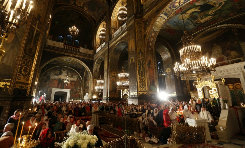 Ukrainian Orthodox believers attend the Orthodox Easter service in St. Volodymyr Cathedral in Kiev, Ukraine, Saturday, April 15, 2017. (