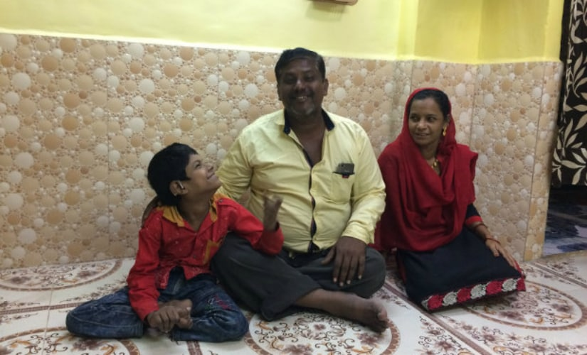 Javed Shaikh with his parents Samsunisa and Abdul Rahman in their new home. Javed's family had to move to Mumbra, 38 km north in Thane district, because their slum in Sewri had been demolished. Javed no longer goes to school. IndiaSpend