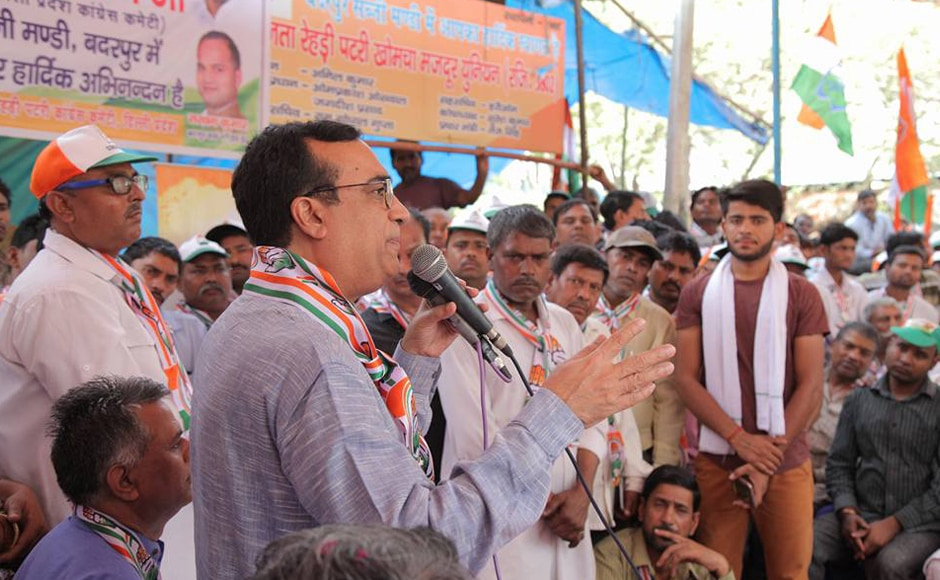 Delhi Congress chief Ajay Maken addresses people during the release of poll manifesto at Satya Niketan market in New Delhi on Wednesday. Facebook/INC Delhi