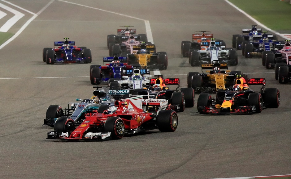 Sebastian Vettel, foreground, overtook Mercedes driver Lewis Hamilton, 2nd left, entering the first curve at the start of the Bahrain Formula One Grand Prix. AP