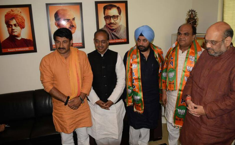 BJP pulled off a major coup ahead of the polls, by getting former Delhi Congress chief Arvinder Singh Lovely to join. He was welcomed into the fold by party president Amit Shah. Image courtesy: Facebook/BJP4Delhi