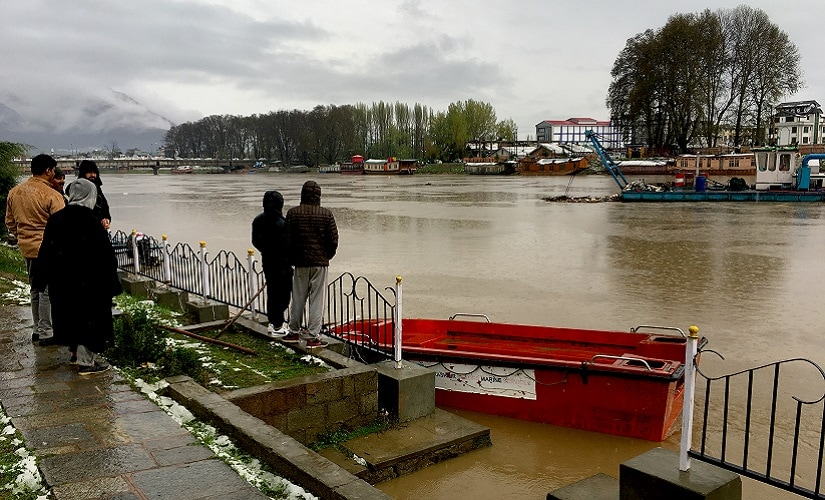 People in the Valley watch as the water level rises in River Jhelum because of the floods. Firstpost/Sameer Yasir