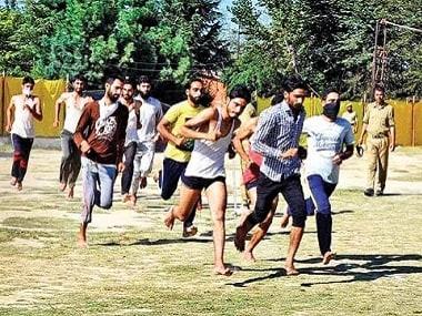 Kashmiri youth run during an army recruitment rally. PTI
