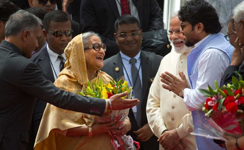 Indian protocol officer, left, introduces Indian Minister of State for Heavy Industries and Public Enterprises, Babul Supriyo, right, to Sheikh Hasina as Modi watches upon her arrival in New Delhi. AP