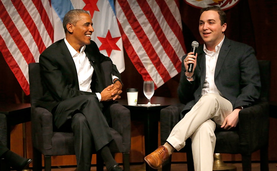 Obama listens to Max Freedman during a conversation at the University of Chicago. Obama talked about his formative experiences as a community organiser and as a young politician running for office in Illinois. AP
