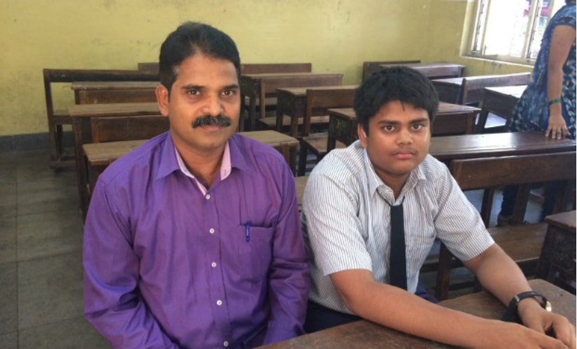 Deepak Khedekar with his son, Sahil, who suffers from hearing impairment and studies in grade VIII at the Baradevi Municipal School, in Sewri, Mumbai. IndiaSpend