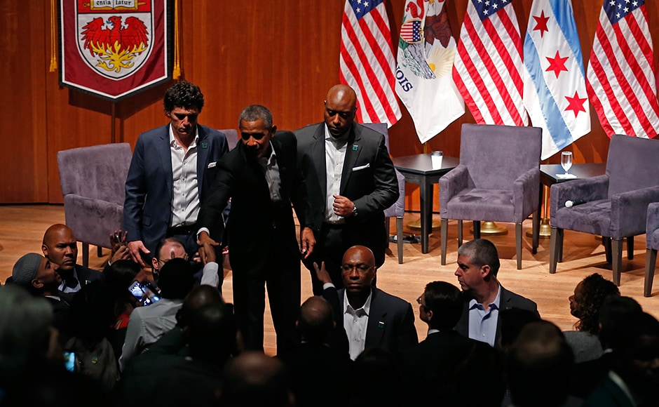 Barack Obama greets audience members after a forum with young leaders to discuss community organising at the University of Chicago in Chicago, Illinois on 24 April. His first public engagement Monday came as President Donald Trump neared his 100-day mark in office. AP