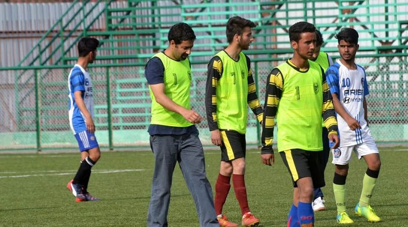 Tassaduq Hussain Mufti (second from left) was recently seen playing football with youngsters in Srinagar, Kashmir. Image source: PDP