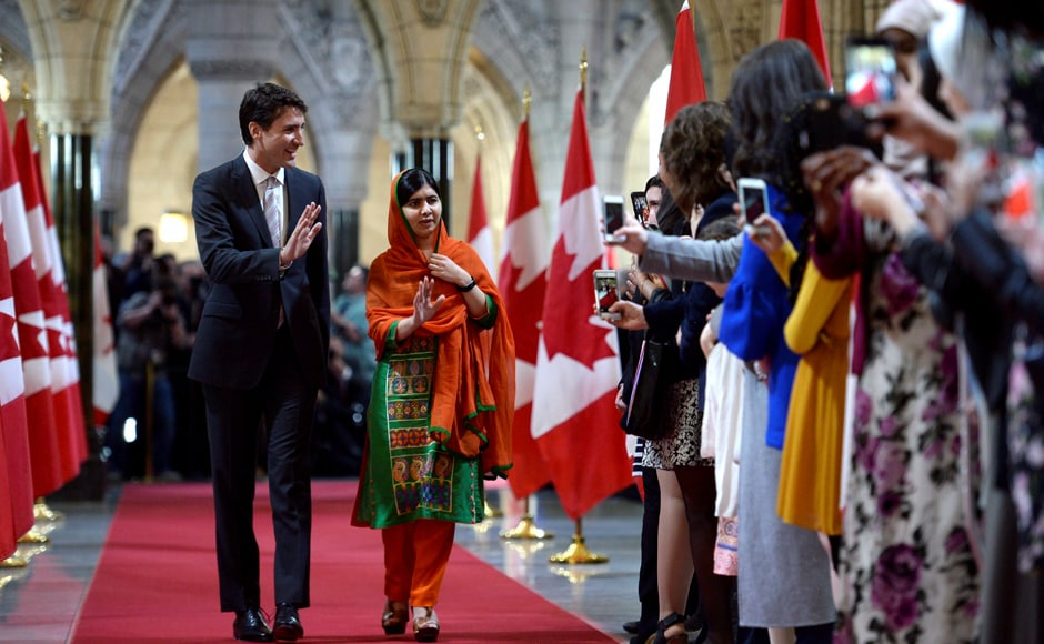 Pakistani activist and Nobel Peace Prize winner Malala Yousafzai, right, walks through the hall of honour with Prime Minister Justin Trudeau on Parliament Hill in Ottawa on Wednesday. AP