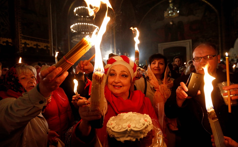 Ukrainian Orthodox celebrates Easter in St. Volodymyr Cathedral during the ceremony of the Holy Fire in Kiev, Ukraine. AP/PTI