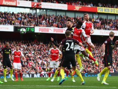 Shkodran Mustafi of Arsenal scores his sides second goal against Manchester City. Getty