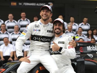 File photo of McLaren driver's Jenson Button, left, and Fernando Alonso. AP