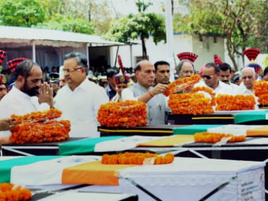 Union Home Minister Rajnath Singh paying tribute to CRPF jawans killed in the Naxal attack in Chhattisgarh's Sukma district, in Raipur on Tuesday.