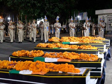 Jawans giving gun salute to martyred CRPF personnel at Patna airport on Tuesday. 25 CRPF jawans were killed in a Naxal attack in Chhattisgarh's Sukma district on Monday. PTI