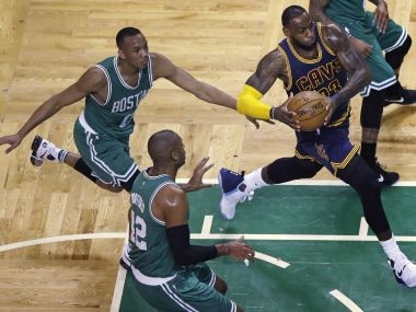 Cleveland Cavaliers forward LeBron James (23) drives to the basket past Boston Celtics players. AP