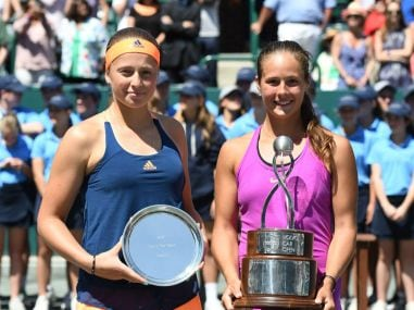 Daria Kasatkina (R) with the winner's trophy after she beat Jelena Ostapenko. Image courtesy: Twitter/@WTA