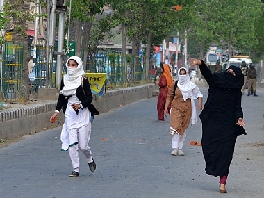 Most of the female students resorted to stone-pelting after they saw their injured classmate in a pool of blood on 20 April. Firstpost/Faisal Khan