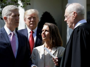 Neil Gorsuch with his spouse, US President Donald Trump and Justice Anthony Kennedy. AP