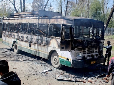 File image of a charred polling staff bus following an attack by a group of protesters  during the Srinagar bypolls. PTI