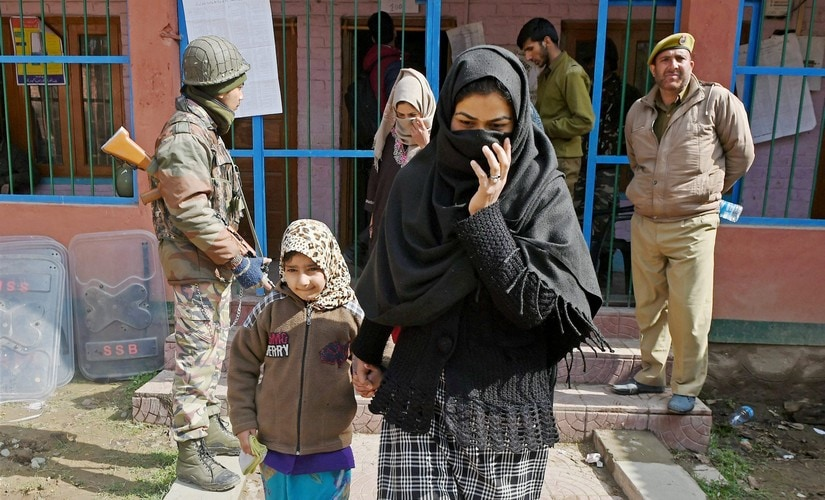Srinagar: Women coming out from a polling station after casting their vote for Srinagar Parliamentary constituency of Jammu and Kashmir at Budgam in Srinagar on Sunday. PTI Photo by S Irfan(PTI4_9_2017_000038B)