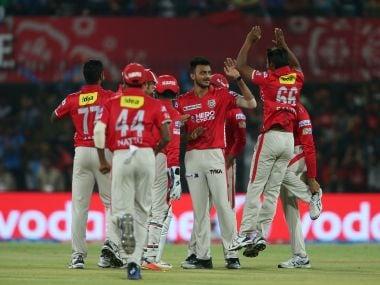 Axar Patel is congratulated by Kings XI Punjab teammates. IPL/Sportzpics