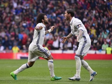 Real Madrid's Marcelo (L) celebrates a goal with Sergio Ramos. AFP