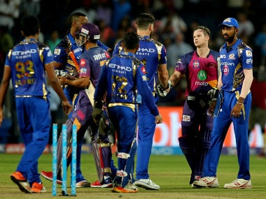 Rising Pune Supergiant's Steve Smith shakes hands with the Mumbai team after their IPL match.