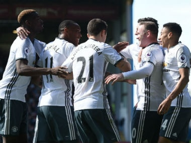 Wayne Rooney and Anthony Martial sink Burnley to ramp up pressure on Manchester City. AFP