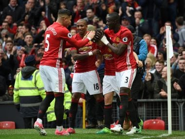 Manchester United's Ander Herrera (C) celebrates scoring with teammates. AFP