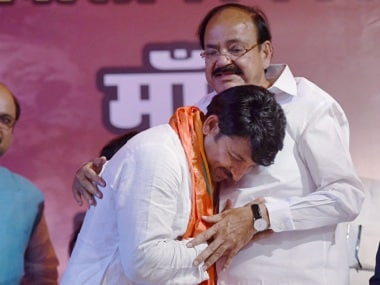 Delhi BJP president with Union minister Venkaiah Naidu after BJP's win in the MCD polls. PTI