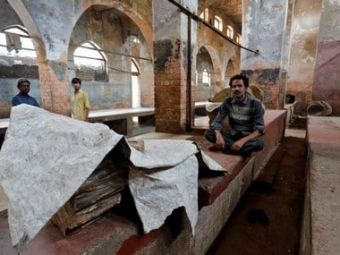 A worker sits inside a closed mutton market in Lucknow, India March 28, 2017. REUTERS/Pawan Kumar