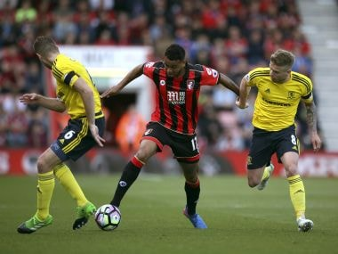 Bournemouth's Joshua King, centre,  battles for the ball with Middlesbrough players. AP